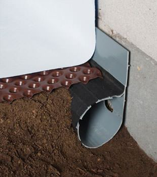 Closeup of a crawl space drainage system installed in Paradise Valley